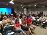 The crowd at the Grapevine Convention Center filed out gradually as Monday night's public hearing went on, but at the start more than 400 residents filled seats and more than a hundred others listened in the hallways as the meeting was piped in through speakers.(Staff/Loyd Brumfield)