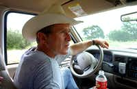 President George W. Bush drove his pickup at his 1,600-acre ranch in sun-baked Crawford, Texas, in 2002. (File Photo/Agence France-Presse)