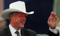 President Bill  Clinton waved to the crowd at a political rally in Sundance Square in Fort Worth in 1996. The hat was given to him by the  publisher of the <i>Fort Worth Star-Telegram</i>. (<p>Richard Michael Pruitt</p>/<p>Staff Photographer<br></p><p></p>)