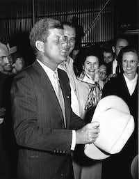 Sen. John F. Kennedy, then president-elect, thanked a Texas delegation from Blanco County and Stonewall for the Western hat they presented to him on his arrival at the LBJ Ranch on Nov. 16, 1960.  Sen. Lyndon B. Johnson, vice president-elect, and Lady Bird Johnson welcomed him. (AP)