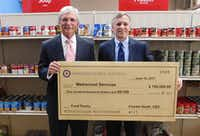 Charles Heath (left), CEO of Metrocrest Hospital Authority, delivered a $100,000 check to Tracy Eubanks, CEO of Metrocrest Services, at its food pantry earlier this year. The hospital authority agreed to give Metrocrest Services up to $100,000 if it raised additional funds through a match campaign.(Samuel Valdez)