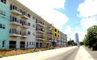 """<p>Developer <span style=""""font-size: 1em; background-color: transparent;"""">Zad Roumaya's Digit 1919 apartments under construction on Akard Street at Cornith.</span></p><p></p>(<div><br></div>Steve Brown<div><br></div><div><br></div><div><br></div>)"""
