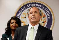 Texas Attorney General Ken Paxton makes comments during a news conference on voter fraud as Dallas County District Attorney Faith Johnson listens. (Tony Gutierrez/The Associated Press)