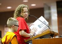 Tracy Thomas (right) with her son Hudson Thomas, 8, submits a petition opposed to a U.S. Highway 380 bypass.(Nathan Hunsinger/Staff Photographer)