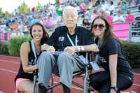 <p>BvB Dallas founder and president Erin Finegold White with her sister Toby Finegold and her grandfather Joe Joe, who was the inspiration for the organization, at the sixth annual Blondes vs. Brunettes Powder-Puff football game at Bishop Lynch High School in Dallas on Aug. 17, 2013.</p>(Alexandra Olivia/Special Contributor)