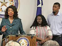 Jordan Edwards' stepmother, Charmaine Edwards (center), and father, Odell Edwards, listen as Dallas County District Attorney Faith Johnson announces that a grand jury indicted Roy Oliver on a murder charge in their son's death.(Louis DeLuca/Staff Photographer)