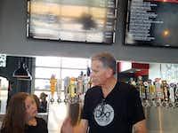 Franchisee Ron Ryan reviews last-minute details with bartender Kristina Ramirez before Saturday's opening of Dog Haus Biergarten in Richardson.(Karen Robinson-Jacobs / Staff)