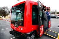 Arlington Mayor Jeff Williams (right) and Deputy City Manager Jim Parajon on a six-seat self-driving shuttle at the Arlington Convention Center in February.(Tom Fox/The Dallas Morning News)