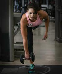 "<span style=""font-weight: normal;"">Meagan Florence works out at Number 1 Fitness in Howe, Texas. After gaining 45 pounds in college, she tried many diets and exercise plans before finding what worked for her. She's now a personal trainer and nutrition coach. </span>(Tailyr Irvine/Staff Photographer)"