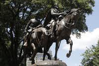 A statue of Confederate Gen. Robert E. Lee stands outside the park named for him in Dallas.(Staff/2015 File Photo)