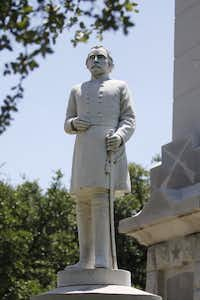 An Albert S. Johnston statue stands outside a Confederate memorial in Pioneer Park Cemetery in Dallas(Staff Photographer/FILE 2015/Michael Reaves)
