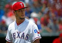 Texas Rangers starting pitcher Yu Darvish (11) walks back to the dugout during the second inning against Los Angeles Angels at Globe Life Park. The Texas Rangers lost 3-0.(Jae S. Lee/Staff Photographer)