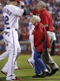 Sister Frances Evans looks up to Texas Ranger Josh Hamilton before throwing out the ceremonial first pitch before the American League Wild Card playoff game at Rangers Ballpark in Arlington on Oct. 5, 2012.(Tom Fox/Staff Photographer)
