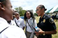 Detroit Deputy Chief Hall speaks with participants in Grow Detroit's Young Talent, a summer job program, during a meeting with citizens at a park in Detroit, on July 20, 2017. Hall is the first female police chief in Dallas history.(Rose Baca/Staff Photographer)