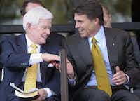 """FILE- In this Sept. 18, 2005, photo, Lonnie """"Bo"""" Pilgrim, CEO and Chairman of the Board of Board of Pilgrim's Pride Chicken, left, shakes hands with Texas Gov. Rick Perry at the Dedication Open House of the companies new headquarters in Pittsburg, Texas.(Herb Nygren/AP)"""