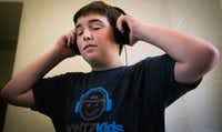 Alex Aughenbaugh listens to music while DJing at his house in Southlake.(Tailyr Irvine/Staff Photographer)