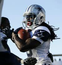 Dallas Cowboys wide receiver Lucky Whitehead (13) carries the ball after making a catch during afternoon practice at training camp in Oxnard, Calif., on Aug. 16, 2016.(Tom Fox/Staff Photographer)