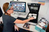 Imagining specialist Erin McClintic works in the lab at Phototronics in Winnetka, Ill., digitizing and archiving a shoebox of customer photographs, right.(AP)