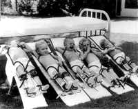 In the shade of large trees at Texas Scottish Rite Hospital  for Children in Dallas, five young polio patients lay  on special stretchers designed to straighten and stretch their legs in 1940. (Texas Scottish Rite Hospital)
