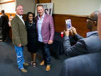 Arlington NAACP president Alisa Simmons has her photo taken with Texas Rangers bench coach Steve Buechele (left) and manager Jeff Banister after a news conference announcing additional endorsements for the new Rangers stadium, which is scheduled to open in 2020(Ashley Landis/Staff Photographer)
