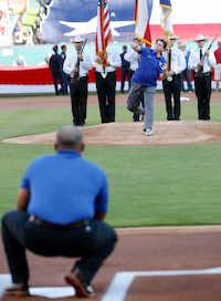 Arlington Mayor Jeff Williams throws the first pitch to Former Texas Rangers catcher Ivan Rodriguez during opening-day ceremonies against the Cleveland Indians at Globe Life Park.(Vernon Bryant/Staff Photographer)