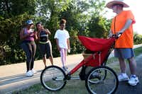 Milt Strong stops while pedestrians take pictures of his chicken Summer along the Katy Trail.(Rose Baca/Staff Photographer)