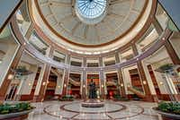 Penney founder James Cash Penney's statue sits in the atrium in the retailer's Plano headquarters.(Christopher Mann/CBRE)