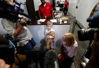 Luke Swofford, 4, and his mother Nikki Swofford talk with the media inside the Lost and Found office Wednesday. (Jae S. Lee/Staff Photographer)