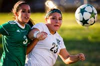 Prosper forward Gabby Gamboa (23) fights for the ball against Mesquite Poteet defender Marisol Jaimes (3) during the first half of a girls Class 5A area-round playoff soccer game.(Smiley N. Pool/Staff Photographer)