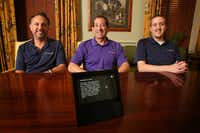 Gary Hooker, chief marketing officer (left), Richard Goodis, director of marketing, and Mark Duncan, senior developer (right), are shown with an Echo Show at University Park City Hall. The Dallas marketing agency is launching a new feature for Amazon Echo that can answer questions about city events, road closures and more. (Rose Baca/The Dallas Morning News)