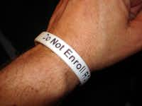 If you wear one of these bracelets, paramedics know not to enroll you in the non-consent medical study. But how do you get them? The Watchdog shows you.(Dave Lieber)