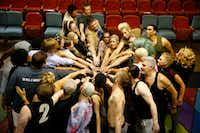 The cast of <i>Pippin</i> cheers before the curtain at The Firehouse Theatre in Farmers Branch on July 21.  (Nathan Hunsinger/Staff Photographer)