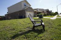 A chair sits on a site marked private property in the Thornton Heights neighborhood in southeast Oak Cliff, where several homes were purchased using the city's Homebuyer Assistance Program. (Nathan Hunsinger/Staff Photographer)