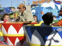 <i>Dallas Morning News</i> metro columnist James Ragland enjoys a ride at the State Fair of Texas with his daughter in 2008.(File Photo)