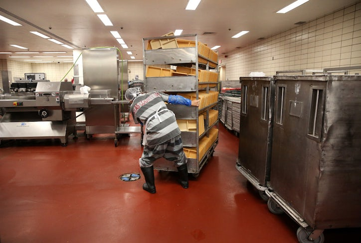 4cac7cfe72c An inmate moves a cart of trays for meal prep in the kitchen at the Lew  Sterrett Justice Center in Dallas. The trusty inmates prepare food for the  Dallas ...