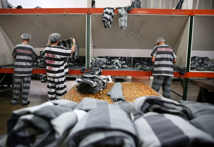 6ec2a2c44bc Inmates fold freshly laundered uniforms at the Cook-Chill facility.