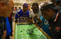 A game goes into overtime during the Electric Football World Championships and Convention at the Westin Dallas Fort Worth Hotel in Irving on Saturday.(Tailyr Irvine/Staff Photographer)