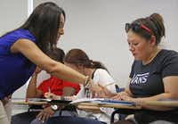 Student Wendy Birdsall, right, gets help from teacher Ana Melgarejo Acosta during Spanish class at SMU on Wednesday, September 23, 2015.(Louis DeLuca/Staff Photographer)