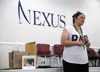Wendy Birdsall, 41, talks to Celanese employee volunteers at Nexus Recovery Center in Dallas on Sept. 25, 2015. Birdsall. Birdsall was homeless at age 15 and had an on-an-off relationship with drugs in her early years. Now she splits her time between a daytime job and classes at SMU.(Rose Baca/Staff Photographer)