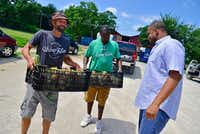 Demler and Horton deliver freshly picked onions to Donald Wesson, program director of Cornerstone in South Dallas.(Ben Torres/Special Contributor)