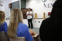 Wendy Birdsall, 41, talks to Celanese employee volunteers at Nexus Recovery Center in Dallas on Sept. 25, 2015. Birdsall. Birdsall was homeless at age 15 and had an on-an-off relationship with drugs in her early years. Now she splits her time between a daytime job and classes at SMU. (Rose Baca/The Dallas Morning News)(Rose Baca/Staff Photographer)