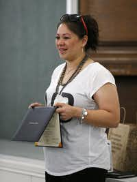 Wendy Birdsall, 41, holds up her diploma from El Centro College while talking to Celanese employee volunteers at Nexus Recovery Center in Dallas on Sept. 25, 2015. Birdsall. Birdsall was homeless at age 15 and had an on-an-off relationship with drugs in her early years. Now she splits her time between a daytime job and classes at SMU. (Rose Baca/The Dallas Morning News)(Rose Baca/Staff Photographer)