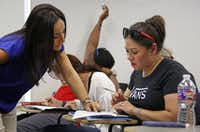Wendy Birdsall gets some help from instructor Ana Melgarejo Acosta's in Spanish class at SMU on Wednesday, September 23, 2015. (Louis DeLuca/The Dallas Morning News)(Louis DeLuca/Staff Photographer)