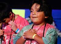 Matthew Rojas, 9, performs with fellow campers at Camp Bravo.(Ron Baselice/Staff Photographer)