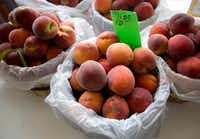 Experts say the mild Texas winter hampered this year's peach crop in parts of the state.(Joyce Marshall/AP)