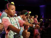 Micah Wilson,7, performs in the show's finale with fellow campers at Camp Bravo.(Ron Baselice/Staff Photographer)