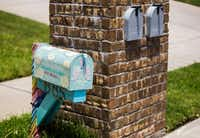 A handmade mailbox in honor of Anistyn Ragan, who died suddenly in December, stands next to other mailboxes outside the Ragan family home.(Ashley Landis/Staff Photographer)