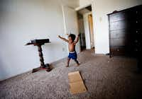 Jordan Miller runs in circles at his new apartment in Dallas. His father, Joshua Miller, saysthe new space has the boy acting like a 2-year-old again. Before moving into the one-bedroom apartment, the Millers were living in a small room at The Family Place's men's shelter. (Tailyr Irvine/The Dallas Morning News)