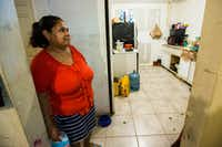 Dalia Palma, stood in the kitchen of her family's home on Monday on Pine St. in Dallas. They purchased the home from a scammer who listed the property on Craigslist for $8,500. The family has spent roughly $50,000 to repair the home since they moved into it in May 2015.(Ashley Landis/Staff Photographer)
