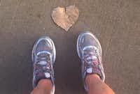 "<p>As I glance at the sidewalk during a run on July 23, I see a heart-shaped leaf -- an ""I love you message,"" from my dad.</p>(Leslie Barker/Staff)"